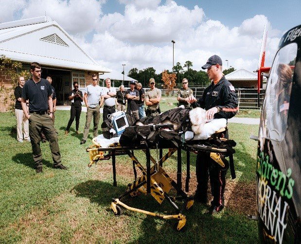 Officers and Life Flight nurses participate in training to transport critically injured K9 officers to emergency veterinary care.