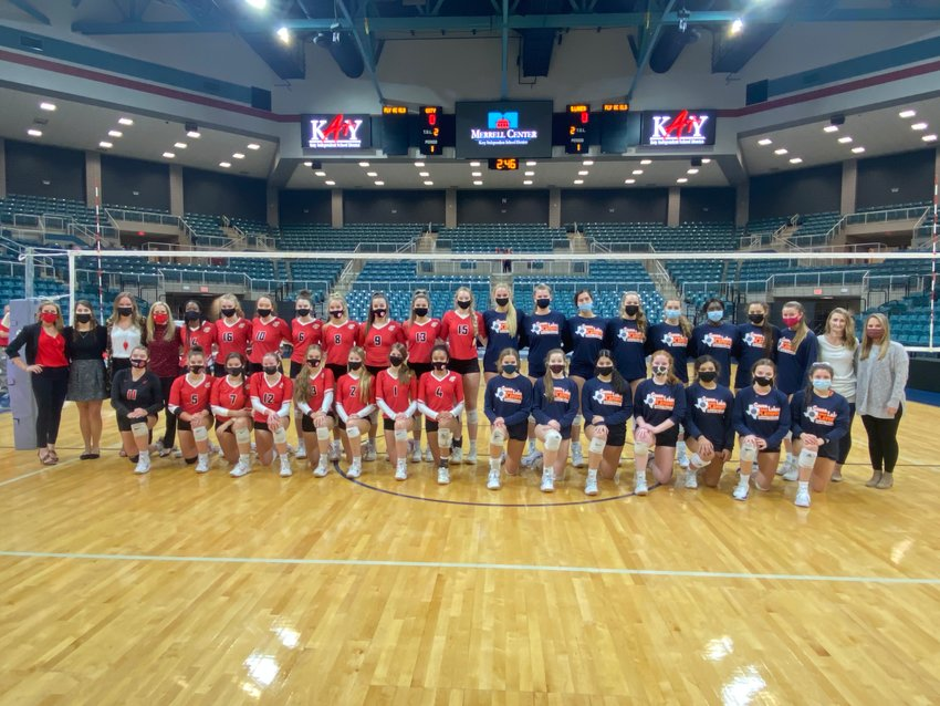 Katy High and Seven Lakes players and coaches posed for a photo before their Class 6A Region III volleyball final at the Merrell Center on Dec. 4. It was the first all-Katy ISD regional final in volleyball.