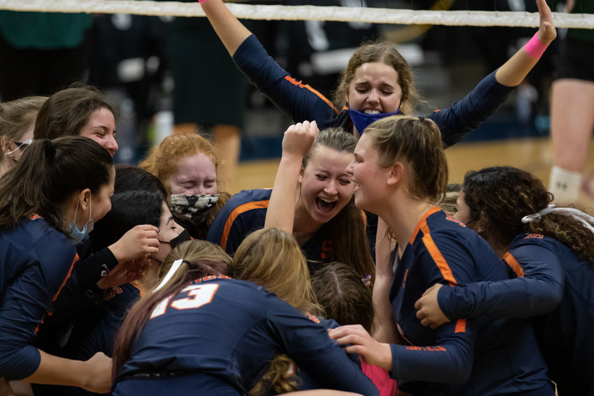 Seven Lakes players celebrate after beating San Antonio Reagan, 3-2, in their Class 6A state semifinal on Dec. 7 at the Merrell Center.