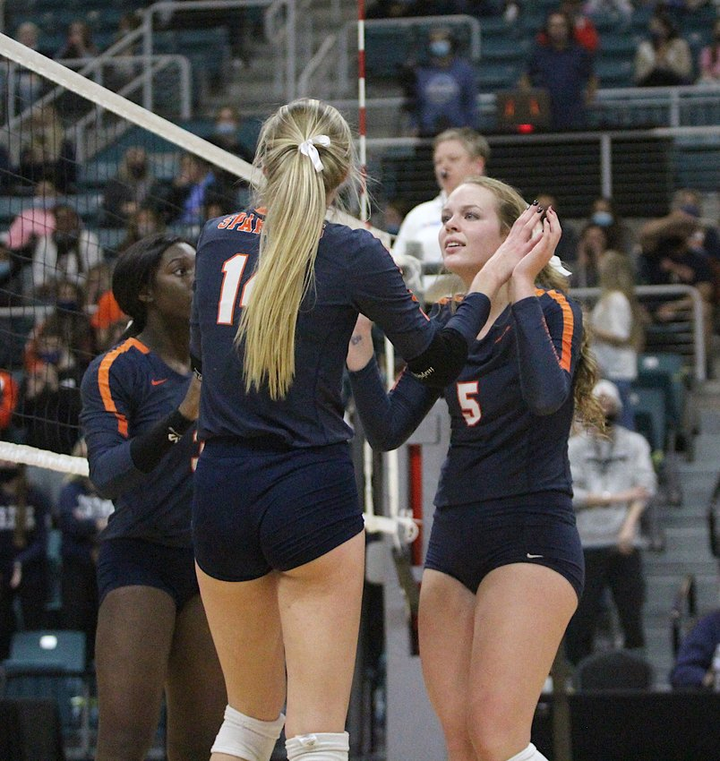 Seven Lakes senior Ally Batenhorst (front) and junior Casey Batenhorst (right) are enjoying the Spartans' remarkable run to the Class 6A state volleyball final. Ally is returning to the state final after making it with her older sister, Dani, in 2017. Now with younger sister Casey, she's hoping the second time can bring home a state title.