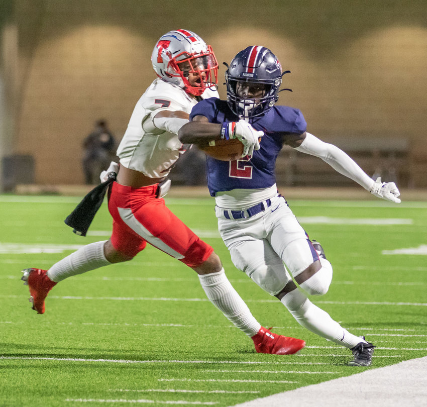 Tompkins senior running back Marquis Shoulders runs with the ball during the Falcons' 42-10 Class 6A Division I bi-district playoff win over Fort Bend Travis on Dec. 11 at Legacy Stadium.
