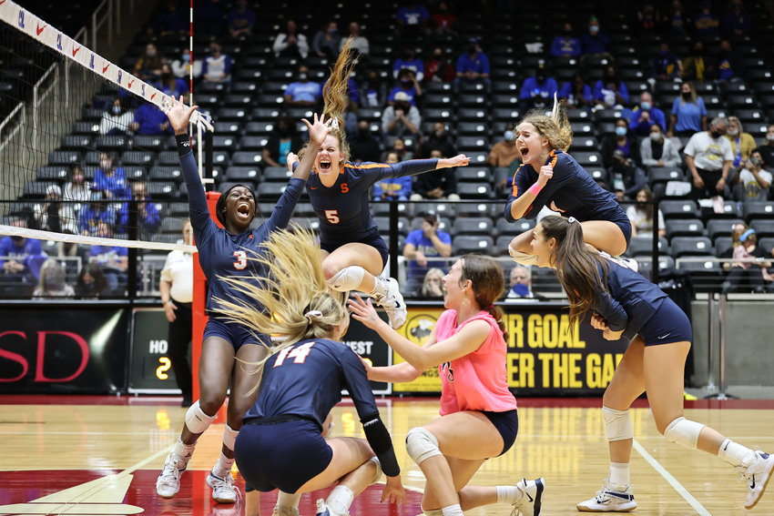 Seven Lakes players celebrate after winning the Class 6A state championship match over Klein on Dec. 12 at the Culwell Center in Garland.