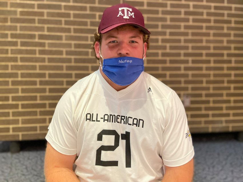 Taylor High senior offensive guard and Texas A&M signee Bryce Foster poses for a photo during a signing ceremony Friday at the performing arts center at Taylor High.