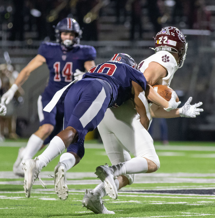 Tompkins senior defensive back Gilbert Koronje (10) brings down Cy-Fair receiver Weston Mounce during the Falcons' Class 6A Division I area playoff win on Dec. 18 at Legacy Stadium.