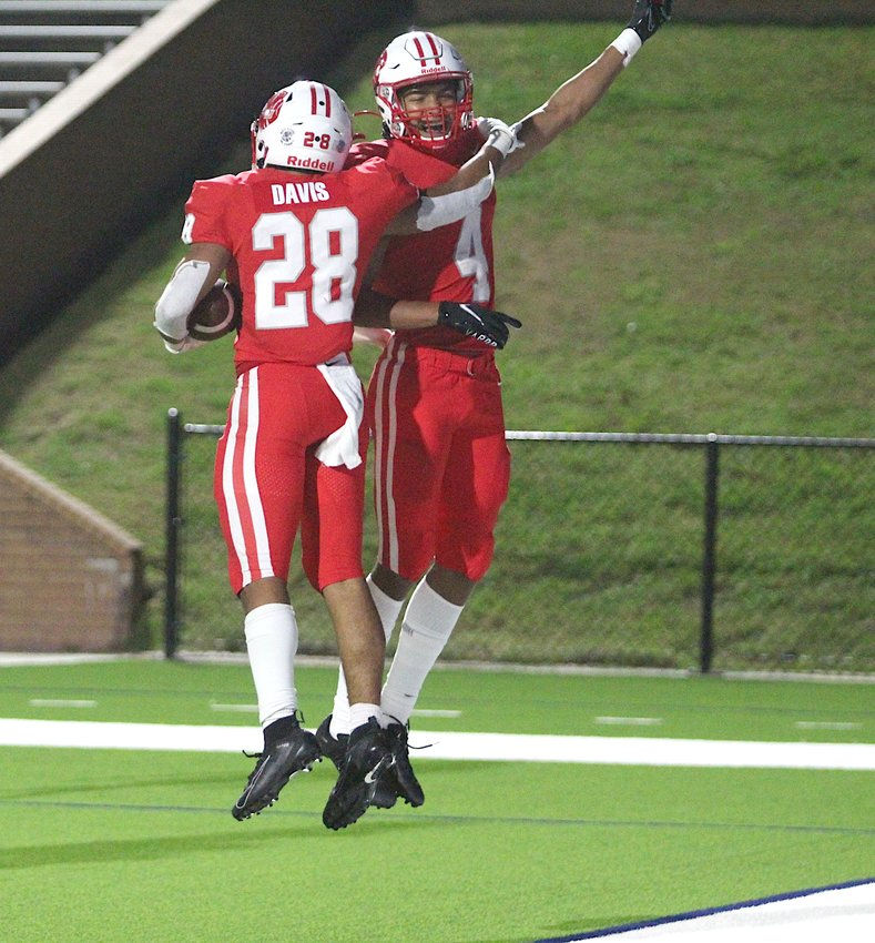 Katy senior running back Jalen Davis (28) and junior receiver Nic Anderson (4) celebrate Davis's touchdown during Katy's 6A D2 area playoff win over Lamar at Rhodes Stadium on Dec. 18.