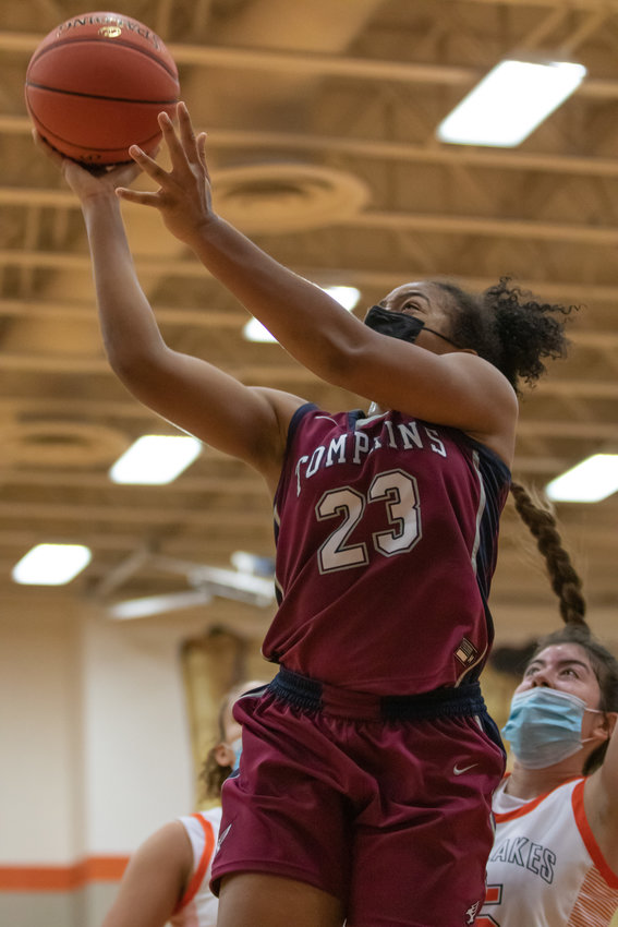 Tompkins sophomore forward Loghan Johnson goes up for a shot during a game against Seven Lakes on Tuesday, Dec. 29, at Seven Lakes High.