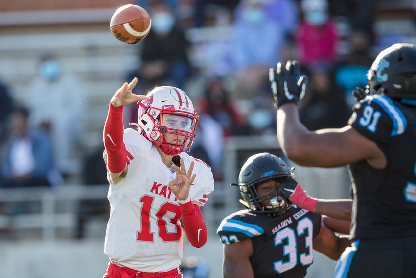 Katy High sophomore quarterback Caleb Koger (10) throws a pass during the Tigers' 49-24 Class 6A-Division II regional semifinal win over Shadow Creek on Saturday, Dec. 26, at Freedom Field in Iowa Colony.