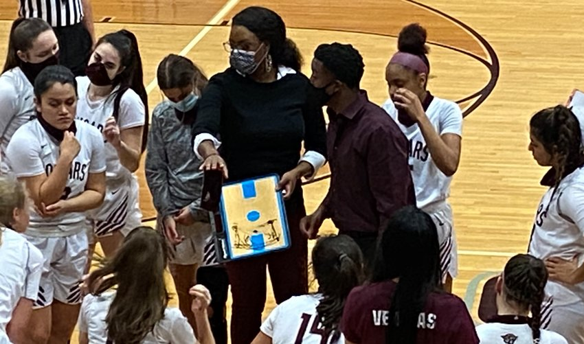 Tamara Collier, in her first year at the helm of Cinco Ranch, talks to her players during a timeout during a game against Morton Ranch on Jan. 6 at Cinco Ranch High.