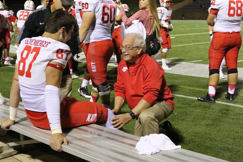 Dr. Mark Bing is pictured treating former Katy High tight end Parker Eichenberger during a high school football game. Dr. Bing served as the team doctor for Katy High for many decades. He died Jan. 9.