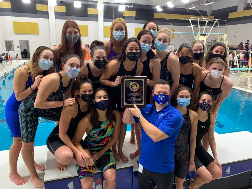 Taylor's girls swim team won the District 19-6A title for the third straight year.