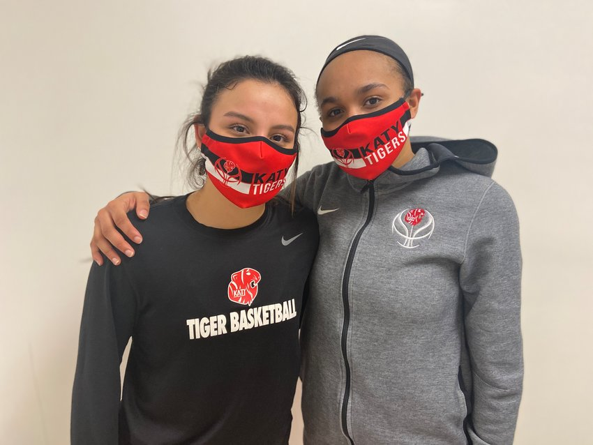 From left to right, Katy senior guards Sasha Fernandez and Amber Bourgeois combined for 18 points to help lead the Tigers to the playoffs courtesy of a 34-24 win over Taylor on Tuesday, Feb. 2, at Taylor High.