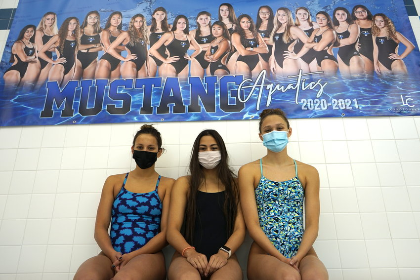 From left to right, Taylor seniors Kat Pashen, Abbie Alvarez and Taylor Schababerle pose for a photo on Monday, Feb. 1, at the Taylor High natatorium.