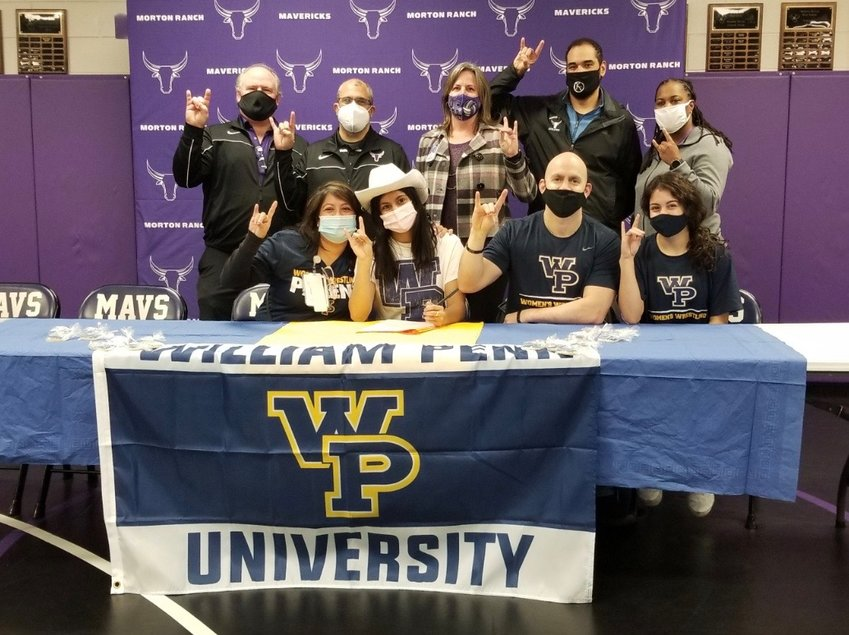 Morton Ranch senior wrestler Brittany Cotter, bottom row in white, signed to continue her athletic career at William Penn University.
