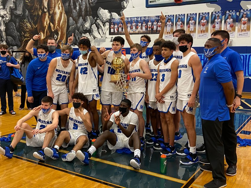 Taylor's boys basketball team fell short of its goal of making it to the third round of the playoffs for the first time in program history, but the Mustangs did accomplish their other two goals of making the playoffs and winning a district championship for the first time since 1995.