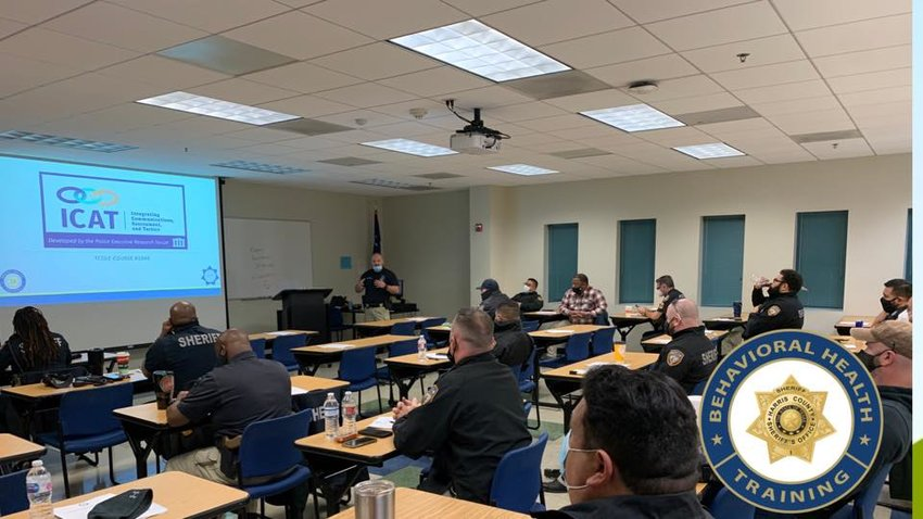 Part of the HCSO Mental Health and Jail Diversion program is intensified de-escalation and training for deputies – both regular street deputies and MHJD deputies – as well as command staff to participate in increased mental health and de-escalation trainings such as the one shown here in this picture. For more information, readers are encouraged to visit www.theharriscenter.org.