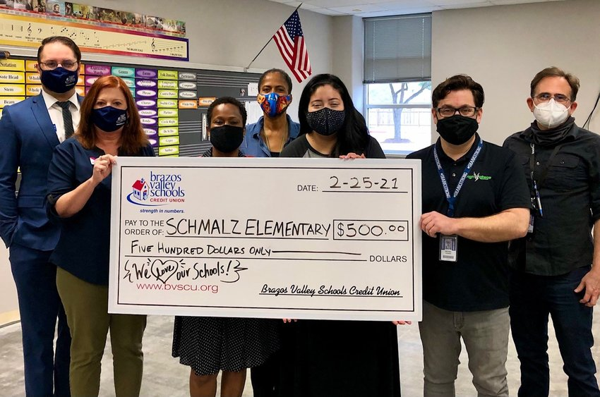 BVSCU staff present Schmalz Elementary School Principal Charlotte Gilder (third from left) with a check for $500 to support the recovery of the school's music program after burst pipes caused damage to the campus the week of Feb. 14.