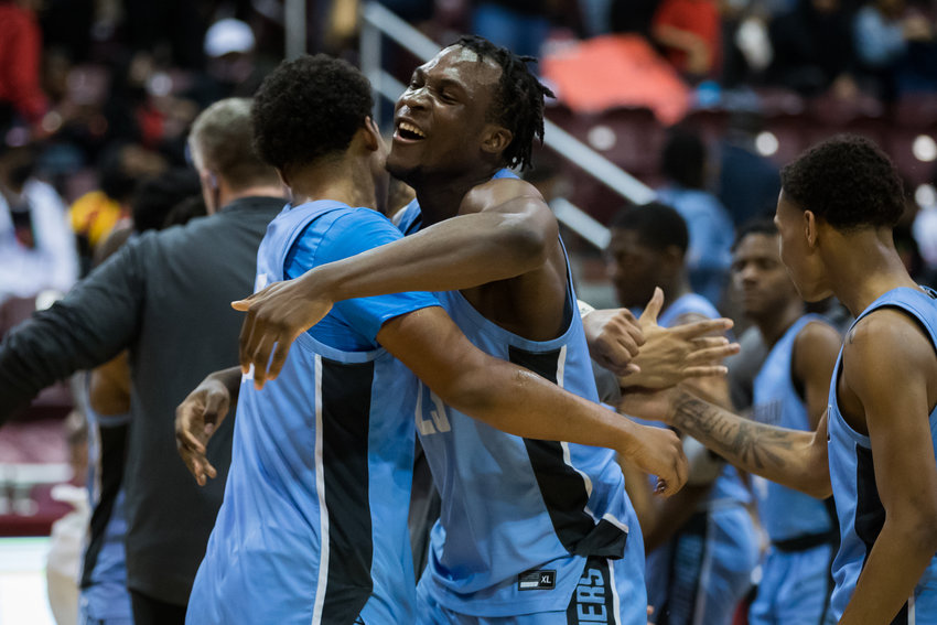 Paetow's Everett Marlatt (22), left, and Charles Chukwu (23) celebrate the Panthers' victory over Goose Creek Memorial in Tuesday's Class 5A Region III semifinals at the Campbell Center in Houston.