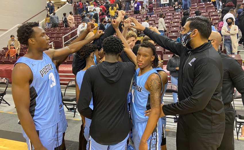 Paetow boys basketball players and coaches huddle as a team after their Class 5A Region III final loss to Beaumont United on Friday, March 5, at the Campbell Center in Aldine.