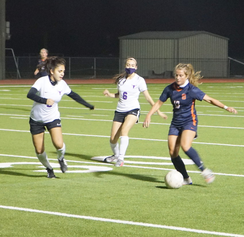Seven Lakes senior Phoebe Harpole (13) controls possession during the Spartans' 7-0 win over Morton Ranch on Tuesday, March 9, at Seven Lakes High.
