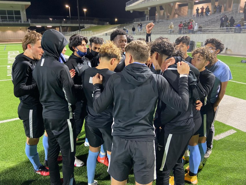 Paetow players gather to pray after their 2-1 win over A&M Consolidated on Friday, March 18, at Legacy Stadium. The win secured the District 19-5A boys soccer title for the second straight season.
