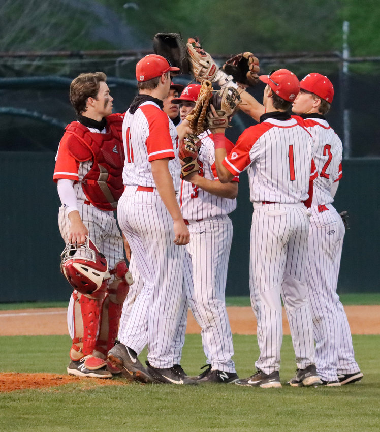 Katy players talk during a break in play during a game against Tompkins on Tuesday, March 30, at Katy High.