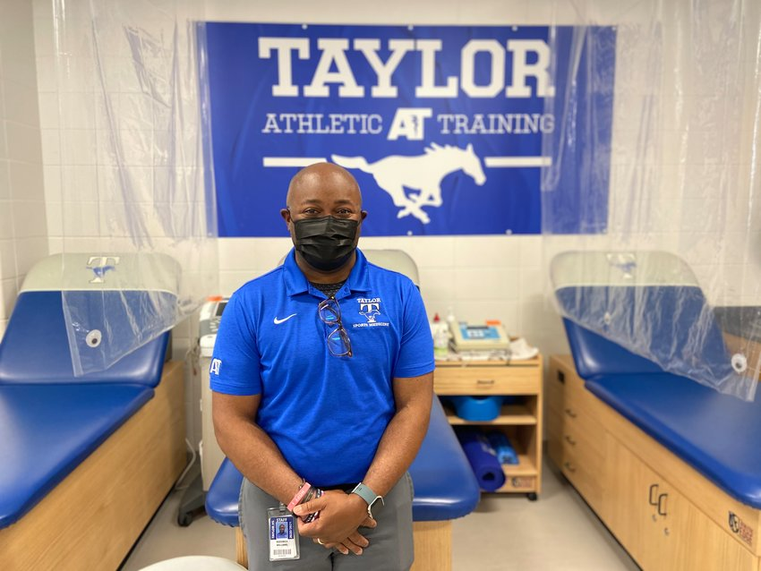 Taylor High head athletic trainer Roderick Williams poses for a photo in the Taylor athletic training room on Tuesday, March 30.