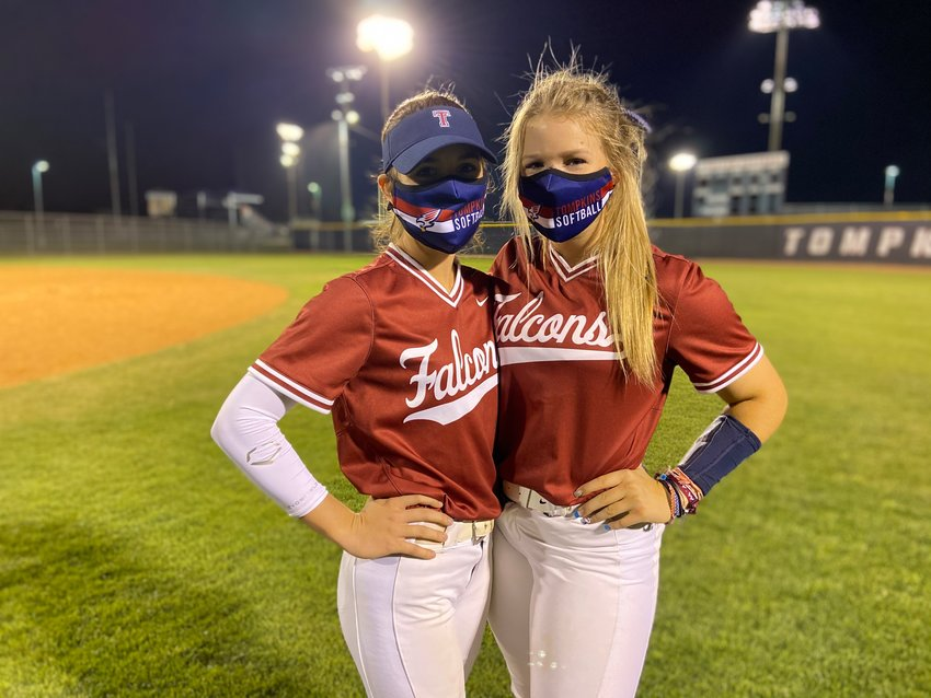 Tompkins senior Taylor Gage, left, and junior Ashley Martinec came up big in the Falcons' 5-3 win over Taylor on Thursday, April 1, to keep hold of second place in District 19-6A.