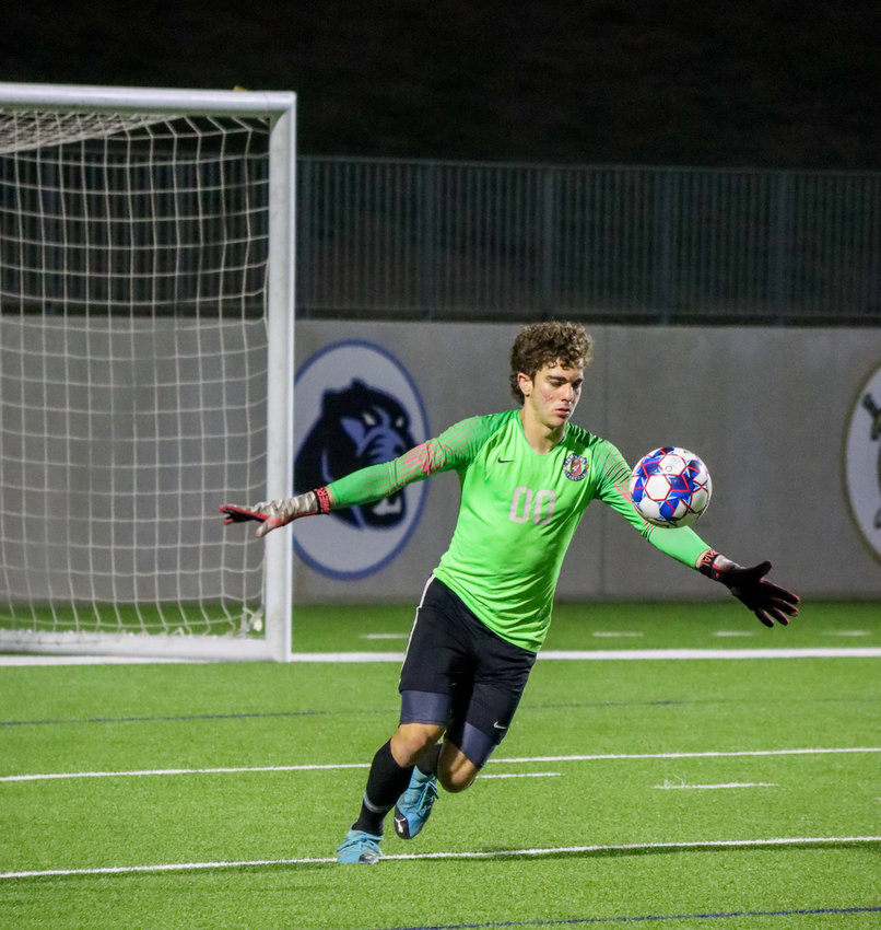 Tompkins senior goalkeeper Paulo Valente makes a stop on the ball during Tompkins' Class 6A Region III final against Jersey Village on Friday, April 9, at Legacy Stadium.