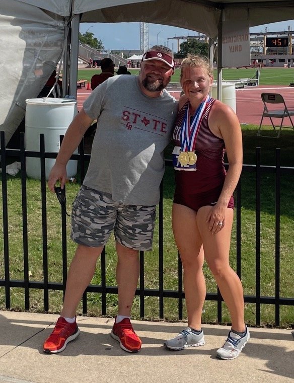 Cinco Ranch senior thrower Amelia Flynt is pictured with her father Darren after winning gold in the discus and shot put throws at the Class 6A state track and field meet Saturday, May 8, at Mike A. Myers Stadium at the University of Texas at Austin.