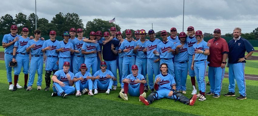 Tompkins baseball coaches and players pose for a photo in celebration of their Game 3 regional quarterfinal win over Cy-Fair on Saturday, May 22, at Tomball Memorial High School.