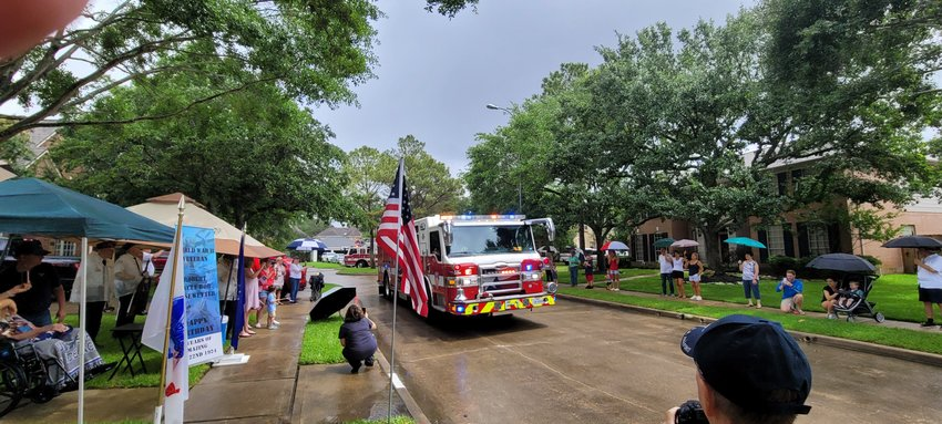 A Harris County Emergency Services District 48 fire truck with lights and siren going passes by Kiesewetter's home during the parade last Saturday. Many of Kiesewetter's neighbors joined veterans, a biker group and others to honor Kiesewetter.