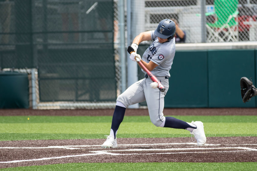 Tompkins junior Jace Laviolette takes a swing during Game 3 of the Falcons' Region III-6A semifinals against Strake Jesuit on Saturday, May 29, at Cy-Falls High.