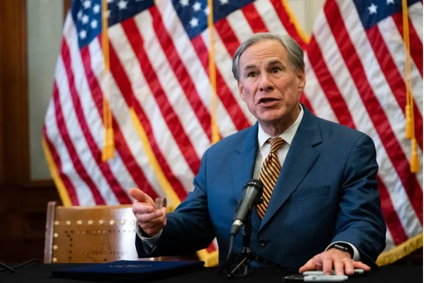 Gov. Greg Abbott signs Senate Bill 2 and Senate Bill 3 at the Texas Capitol on June 8, 2022. The omnibus power grid bills will change the state's power grid and the people who oversee it.