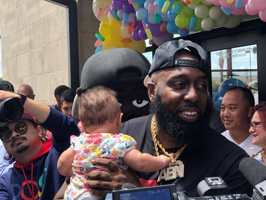 Houston rap artist Trae the Truth poses with a youngster, whose father told the rapper that the baby was named in Trae's honor.