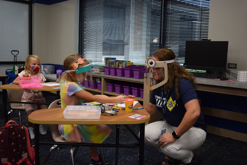 McElwain Elementary School Principal Euberta Lucas spends time with a student on the first day of in-person school for the 2020-21 school year Sept. 9, 2020. Last school year was a roller coaster for many students as parents navigated safety concerns amid the first pandemic in more than a generation while trying to master the art of digital schooling, remote working and social distancing.