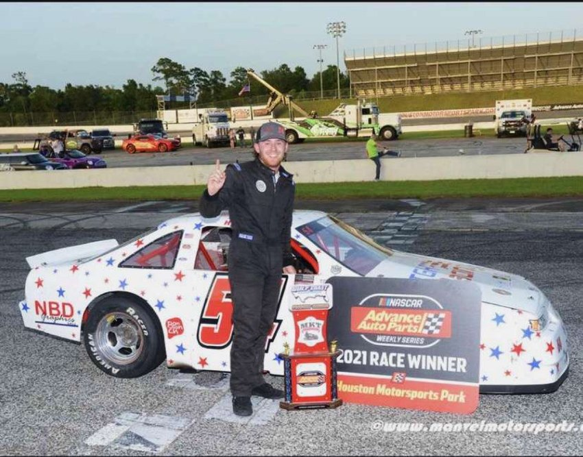 Ty Hymel stands in victory lane at Houston Motorsports Park after winning the NASCAR Advanced Auto Parts Weekly Series race on July 17.