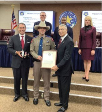 State Trooper Drew Stoner of Rosenberg is presented with the Medal of Valor by DPS Director Steven McGraw (right, front) during an Aug. 12 ceremony in Austin. Stoner witnessed a shooting and provided aid to one of the victims after arresting the perpetrator this past Feb. 20 near his home.