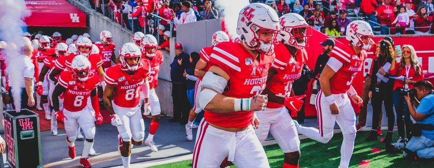Houston players take the field for a game last season