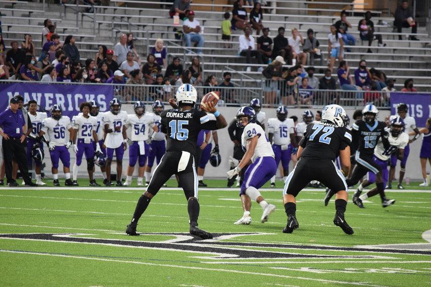 Paetow quarterback CJ Dumas prepares to throw a pass during a game on Friday against Morton Ranch at Legacy Stadium.