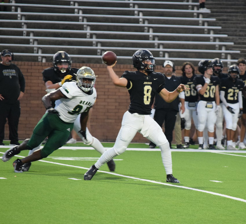 Jordan's Colin Willetts throws a pass during a game against Little Cypress-Mauriceville on Thursday at Rhodes Stadium.