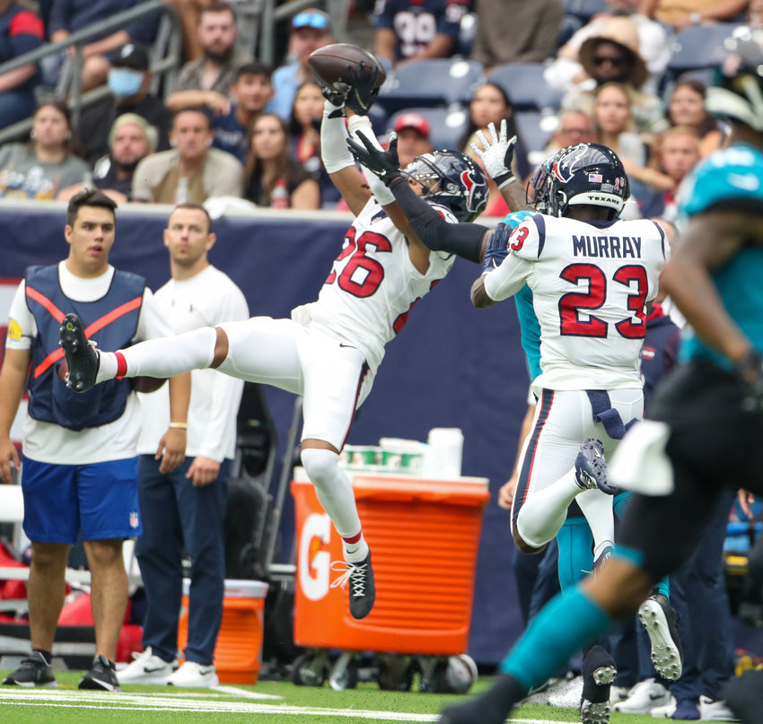 Houston Texans cornerback Vernon Hargreaves III (26) leaps to intercept a pass thrown by Jacksonville Jaguars quarterback Trevor Lawrence (16) during the first half of an NFL game between the Houston Texans and the Jacksonville Jaguars on September 12, 2021 in Houston, Texas.