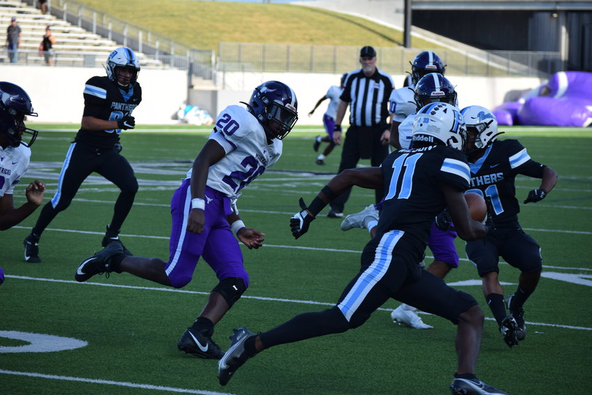 Kole Wilson returns a punt during a game against Morton Ranch at Legacy Stadium on Sept. 3.