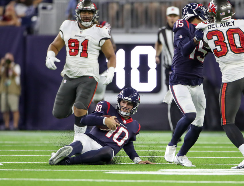 Houston Texans quarterback Davis Mills (10) slides after a 15-yard scramble during an NFL preseason game between the Houston Texans and the Tampa Bay Buccaneers on August 28, 2021 in Houston, Texas.