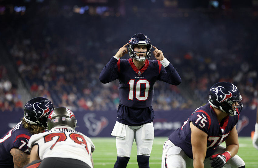 Houston Texans quarterback Davis Mills (10) prepares to take a snap during an NFL preseason game between the Houston Texans and the Tampa Bay Buccaneers on August 28, 2021 in Houston, Texas.