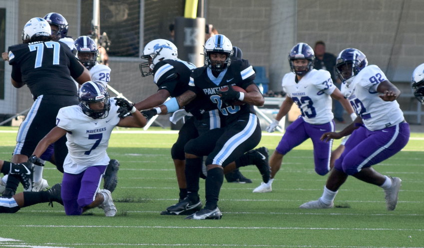 Paetow's Jacob Brown tries to make a spin move to avoid the defense during a game against Morton Ranch on Sept. 3 at Legacy Stadium.