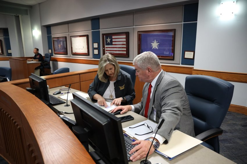 Katy ISD trustees Rebecca Fox and Duke Keller review documents during the KISD Board of Trustees' meeting on Monday, Sept. 27. Student enrollment in the Katy Virtual Academy has dropped by 15% since its relaunch in August. As of Monday, enrollment is 3,555 students, deputy superintendent Leslie Haack said.