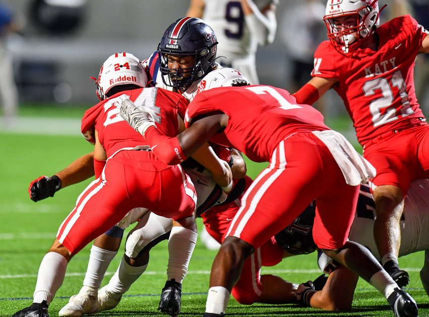 Katy, Tx. Oct 1, 2021:  On a fourth and goal, Katy's defense holds off Tompkins from scoring during a conference game between Katy Tigers and Tompkins Tompkins Falcons at Legacy Stadium. (Photo by Mark Goodman / Katy Times)