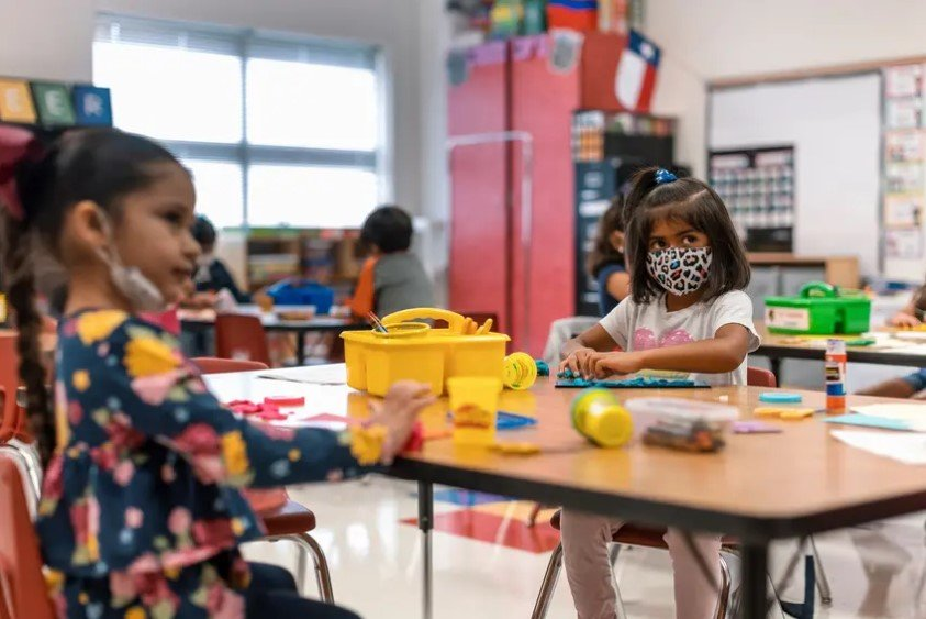 Kindergarten students work at their desks at Blanco Vista Elementary School in San Marcos. Plaintiffs say the governor's order denies children with disabilities, who are at a high risk of illness and death from the coronavirus, access to public education.