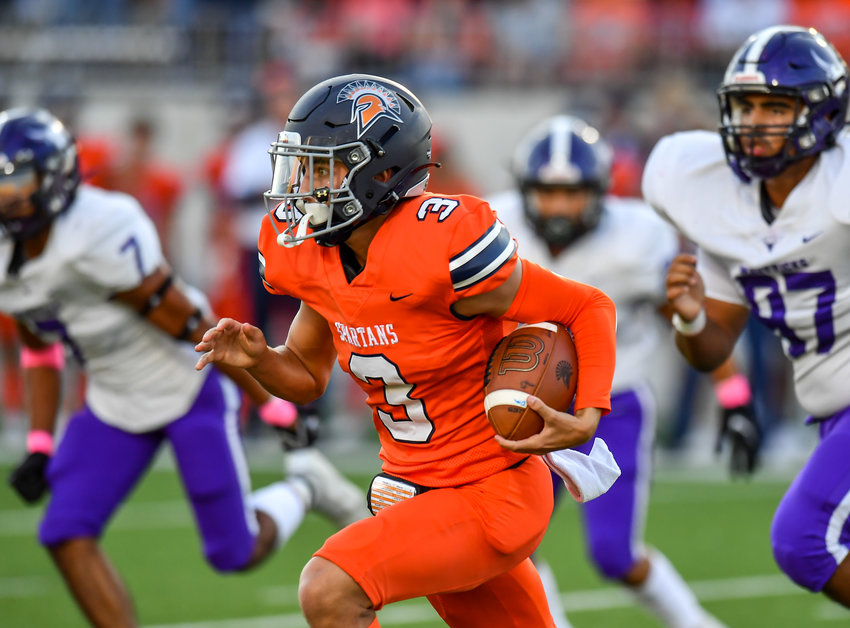 Katy, Tx. Oct 8, 2021: Seven Lakes QB Grayson Medford #3 carries the ball to the outside during a District 19-6A game between Seven Lakes and Morton Ranch at Legacy Stadium in Katy. (Photo by Mark Goodman / Katy Times)