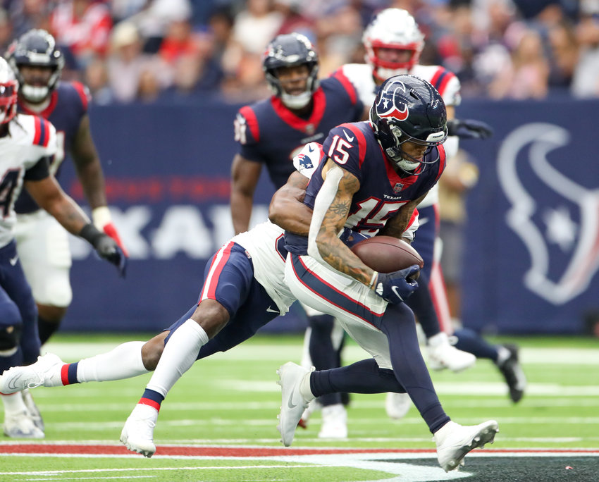 Houston Texans wide receiver Chris Moore (15) bobbles and then secures a pass during an NFL game between Houston and New England on October 10, 2021 in Houston, Texas. The Patriots won 25-22.